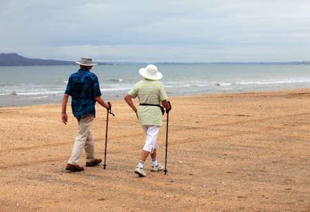 Senior couple on the beach at sunset Stock Photo
