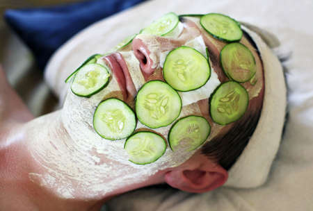 Mask from fresh cucumbers on face man