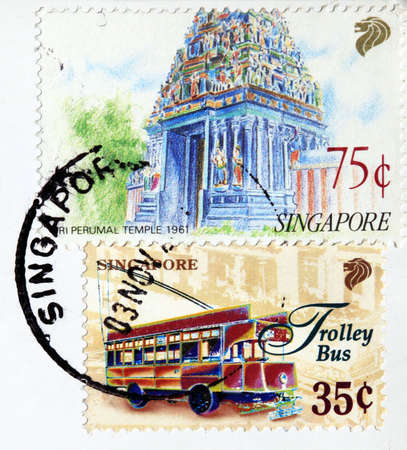 Postage stamp on a postcard with a mark of Singapore