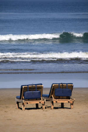bali beach: Inviting wooden chairs on a Bali beach Stock Photo