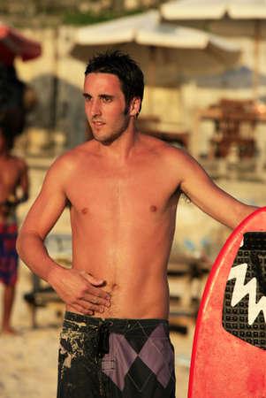Portrait young men - the surfer pending waves Stock Photo - 4864759
