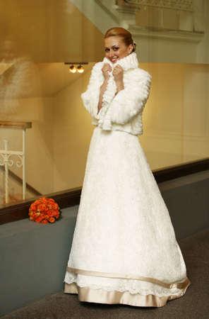 The beautiful frozen bride in a white fur coat Stock Photo - 4917825