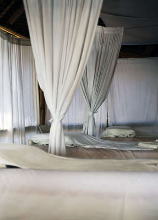 Room for massage with white curtains