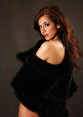 head dress: Portrait of the beautiful brunette in studio