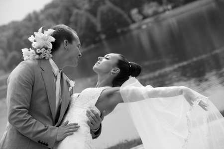 Newly-married couple in park Stock Photo - 5288089