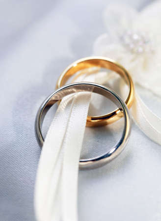 faithfulness: Wedding rings on a satiny fabric