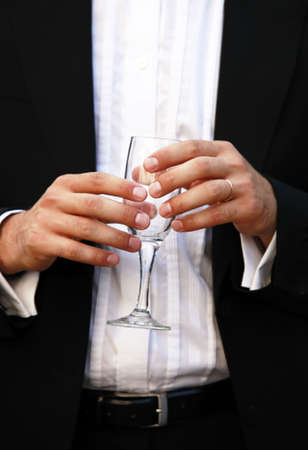 Glass of champagne in a hand of the groom Stock Photo - 5368033