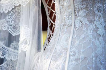Detail of white wedding dress and veil Stock Photo - 5368043