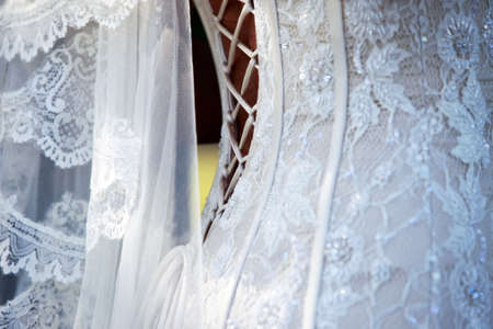 Detail of white wedding dress and veil Stock Photo - 5368043