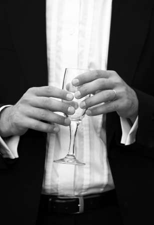 Glass of champagne in a hand of the groom Stock Photo - 5420831