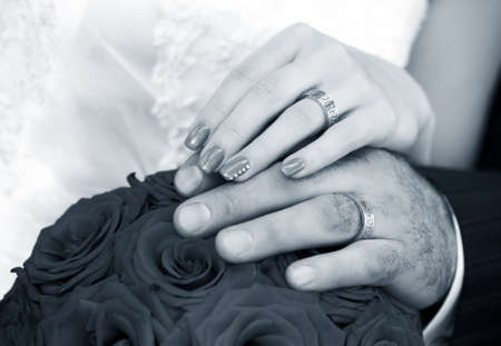 Hand of the groom and the bride with wedding rings photo