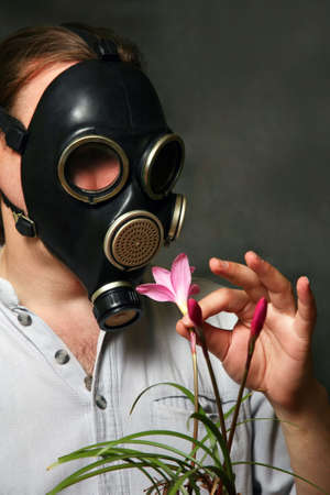 The man in a gas mask with flowers photo