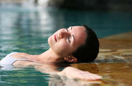 Beautiful woman enjoying summer in the pool photo