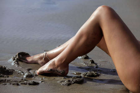 Beautiful legs young girl on beach  photo