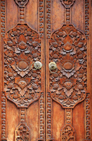 Wooden door decorated with a groove photo