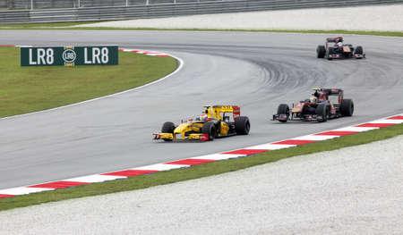 f1: SEPANG, MALAYSIA - APRIL 4 : Renault F1 driver Vitaly Petrov of Russia drives during Petronas Malaysian Grand Prix at Sepang F1 circuit April 4, 2010 in Sepang