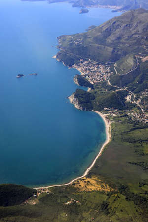 Kind at coast on Budva from an airplane from the height of bird flight. Montenegro photo
