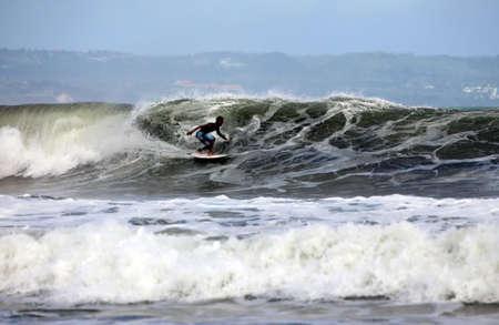 bodyboard: Young men - the surfer in ocean. Bali. Indonesia