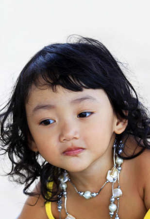 Portrait of the beautiful small Asian girl.  Indonesia. Java photo