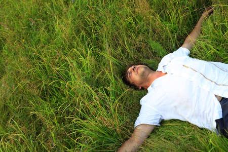 weakening: Adult the man weakening in a grass