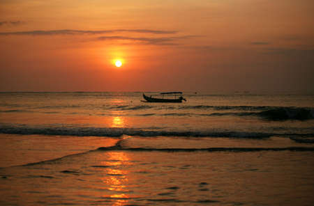 Drifting boat on a sunset. Coast of the Indian ocean. Bali Stock Photo - 7649070