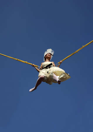 belonging to the caucasoid race: The bride jumping against the blue sky