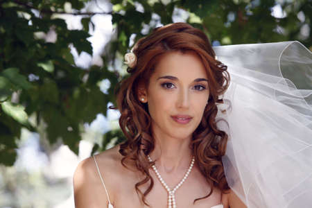 The beautiful bride on a green background Stock Photo - 7696005