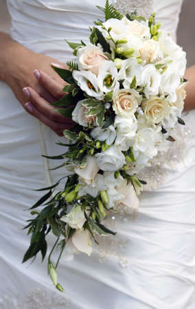 bridal bouquet: The bride holds a wedding bouquet