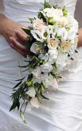 bridal bouquet: The bride holds a wedding bouquet