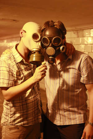 Two men in gas masks with flower in the tunnel photo