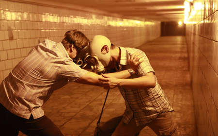 Two men in gas masks in the tunnel photo