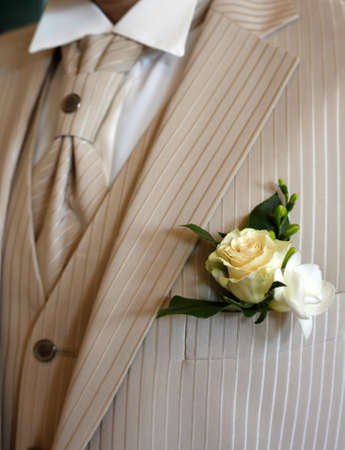 buttonhole: Buttonhole with flowers detail of grooms wedding dressup Stock Photo