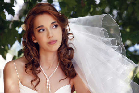 The beautiful bride on a green background Stock Photo - 7696306