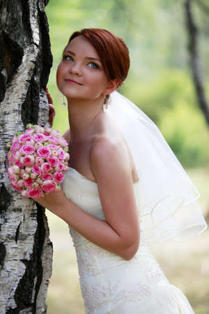 The beautiful bride with bouquet in park Stock Photo - 7696268