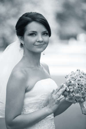 The beautiful bride with bouquet in park Stock Photo - 7696263
