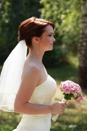 The beautiful bride with bouquet in park Stock Photo - 7696267