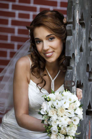 The beautiful bride with bouquet in park Stock Photo - 7696301