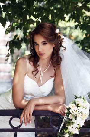 The beautiful bride on a green background Stock Photo - 7696305