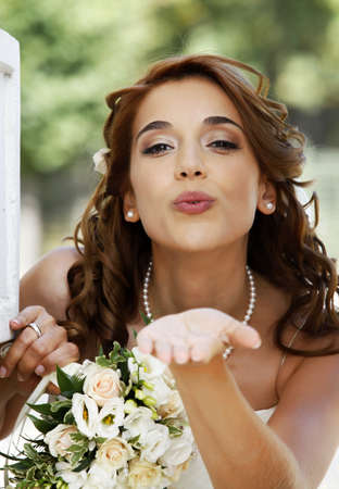 The beautiful bride with bouquet in park Stock Photo - 7933638