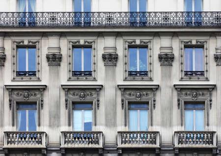 The facade of apartment building in Paris Stock Photo - 8020707