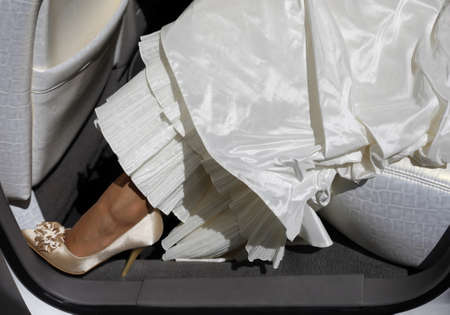 garter: Wedding shoes. The bride in the automobile