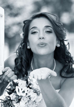 The beautiful bride with bouquet in park Stock Photo - 8020709