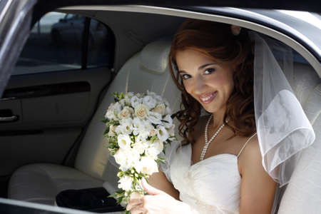 married: The beautiful bride in the automobile