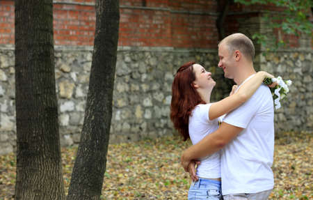 without clothes: Newly-married couple without wedding clothes in park