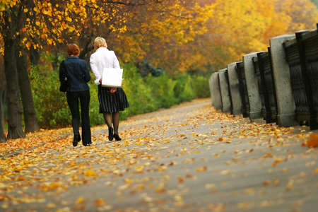 The two lonely girls in autumn park Stock Photo - 8020737