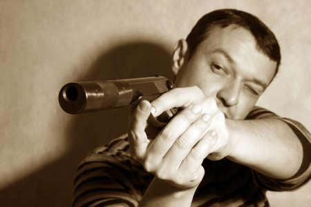 The man with a pistol on a background Stock Photo - 8300193