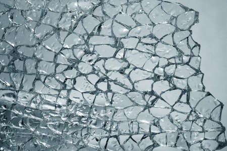The broken glass with drops is strongly dim photo