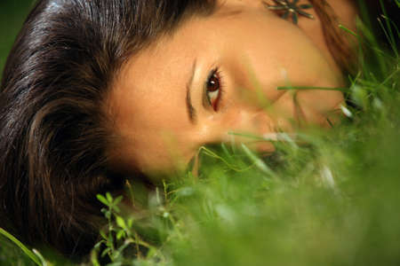 The girl in a grass. The face close-up Stock Photo - 8420726
