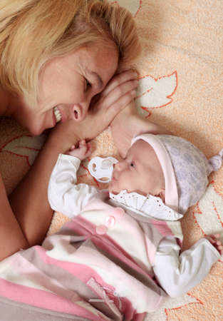 Mother with her newborn baby in home Stock Photo - 8582539
