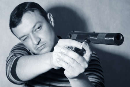 The man with a pistol on a background Stock Photo - 8667164